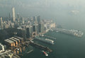 Victoria harbour hong kong with mist day of view from international commerce centre of tsim sha tsui of Stock Images