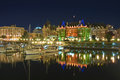 Victoria inner harbour and empress hotel by night bc july historic fairmont in bc collects messages for the new royal baby photo Stock Image