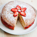 Victoria sponge cake with strawberries on a wooden table jam and whipped cream square Stock Images