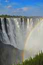 Victoria waterfall rainbow falls and formed in the water spray zambezi river zimbabwe africa Stock Photo