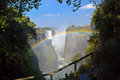 Victoria waterfall rainbow falls and formed in the water spray zambezi river zimbabwe africa Stock Photography