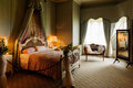 Victorian bedroom with large bed Royalty Free Stock Images