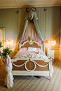 Victorian bedroom large bed in a classic Royalty Free Stock Photography