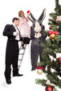 Victorian couple with rabbit near a Christmas tree Stock Photography