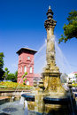 Victorian Fountain and Dutch Clock Tower Stock Photos