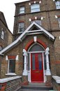 A victorian house and door london in england with entrance area Stock Photos