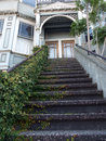 Victorian house entrance, ivy covered stairs Royalty Free Stock Photo