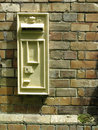 Victorian postbox in a brick wall Stock Photography
