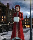 Victorian style woman walking down a 19th century London street Royalty Free Stock Photo