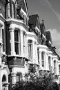 Victorian terraced town houses black and white monochrome photograph of in london england uk Stock Photo