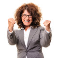 Victorious female executive cheerful with clenched fists celebrating success isolated over white background Stock Photos