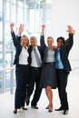 Victorious team of business people at the hallway Royalty Free Stock Images