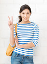Victory bright picture of lovely teenage girl showing sign Stock Photography