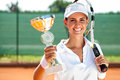 Victory female tennis player won the cup at the sport competition prize and Royalty Free Stock Images