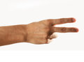 Victory hand close up mans in gesture against white background Royalty Free Stock Photography