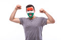 Victory happy and goal scream emotions of hungarian football fan in game support of hungary national team on white background Royalty Free Stock Photos