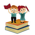 The victory of the knowledge a beautiful couple standing above two big books Royalty Free Stock Photo