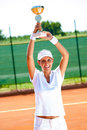 Victory at the sport competition pretty tennis player won cup Stock Image