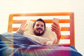 Video call at bed. Royalty Free Stock Photo