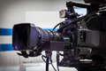 Video camera lens recording show in tv studio focus on aperture Royalty Free Stock Image