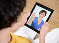 Video chat communication via Apple iPad Stock Images