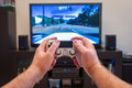 Video game console controller in man hands Royalty Free Stock Photo