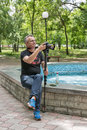 Videographer is shooting in city park of Voznesensk, Ukraine. Royalty Free Stock Photo