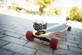 Videotaping on longboard equipped with two extreme cameras Royalty Free Stock Photos