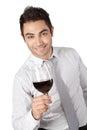 Vidro de holding red wine do homem de negócios Imagem de Stock Royalty Free