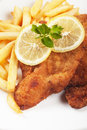 Viener schnitzel breaded steak with french fries vienner and lemon Royalty Free Stock Image
