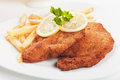 Viener schnitzel breaded steak with french fries vienner and lemon Stock Photography