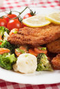 Viener schnitzel breaded steak with healthy vegetables broccoli caulifolwer and carrot Royalty Free Stock Photo