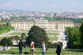 VIENNA, AUSTRIA - APR 30th, 2017: Classic view of famous Schonbrunn Palace with Great Parterre garden with people Royalty Free Stock Photo