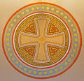 Vienna - Cross in the round. Detail from fresco on the wall in Carmelites church in Dobling. Stock Photos
