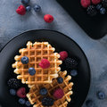 Vienna wafers with juicy ripe berries of blueberry and raspberry Royalty Free Stock Photo