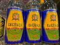 View on isolated bottle labels of brasilian Don Diego cachaca in shelf of german supermarket Royalty Free Stock Photo
