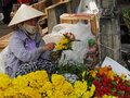 Vietnam, Quang Nam Province, Hoi An City, Old City listed at World Heritage site by Unesco, the Market, Woman selling Flowers Royalty Free Stock Photo