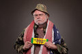 Vietnam veteran with war tag american flag around his neck holding a Royalty Free Stock Image
