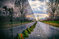 Vietnam War Memorial with Washington Monument at Sunrise, Washington, DC, USA Royalty Free Stock Photo