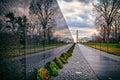 Vietnam War Memorial with Washington Monument at Sunrise, Washington, DC, USA
