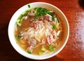 Vietnamese beef noodles pho soup a photograph showing the popular vietnam cuisine of rice noodle cooked in broth and served with Royalty Free Stock Image
