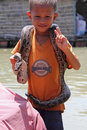 Vietnamese Boy Showing A Snake Royalty Free Stock Photos