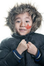 Vietnamese canadian boy with winter jacket hood on white background Royalty Free Stock Photo