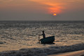 Vietnamese fisher and setting sun Royalty Free Stock Photo