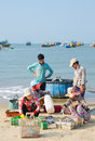 Vietnamese fishers mui ne vietnam march unidentified women sort out the fish their husbands have caught march mui ne vietnam Stock Images