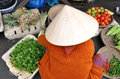 A vietnamese market woman selling vegetables in hoian Stock Photography