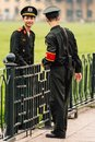 Vietnamese police officers talking with each other on the green field in front of Ho Chi Minh Mausoleum at Hanoi, Vietnam