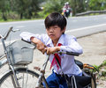 Vietnamese school boy a with his bicycle Stock Image