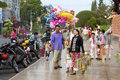 Vietnamese Street Balloon Vendor Stock Photography