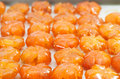 Vietnamese sweetened kumquats traditional snack during lunar new year tet Stock Photo